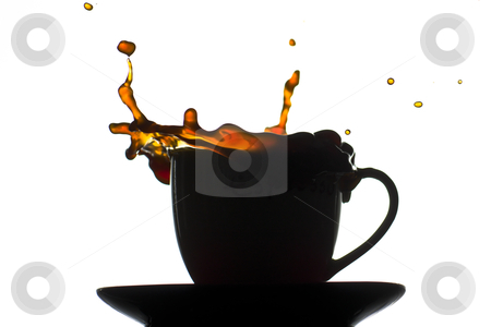 Coffee splash stock photo, A silhouette of a coffe cup splashing andspilling coffee by BJphotography