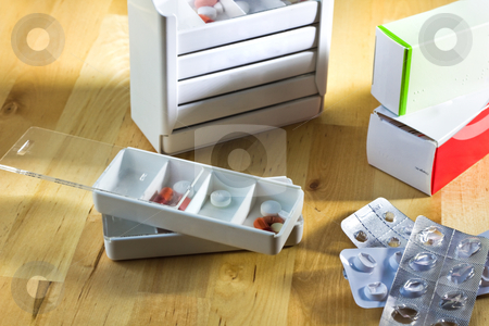 Tablets, capsules and pills sorted in pillboxes stock photo, Tablets, capsules and pills sorted in pillboxes for daily use as medication by Colette Planken-Kooij