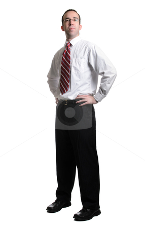 Success stock photo, A full length view of a successful businessman standing with his hands on his hips, isolated against a white background. by Richard Nelson