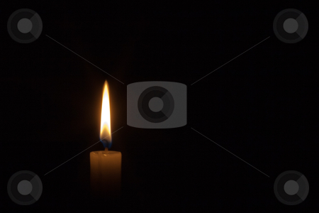 Candlelight stock photo, Single candlelight in the dark by Gert Lavsen