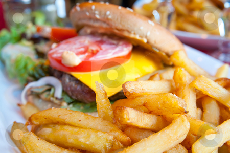 Cheese burger stock photo, Cheese burger - American cheese burger with fresh salad by ilolab