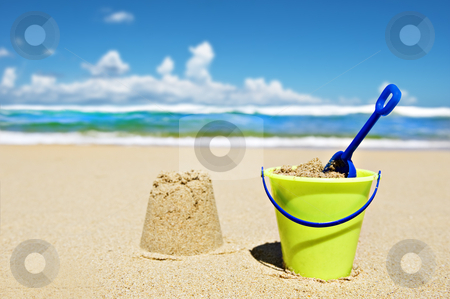 Toy bucket and shovel on the beach stock photo, Toy bucket and shovel on the beach on a sunny day by tish1