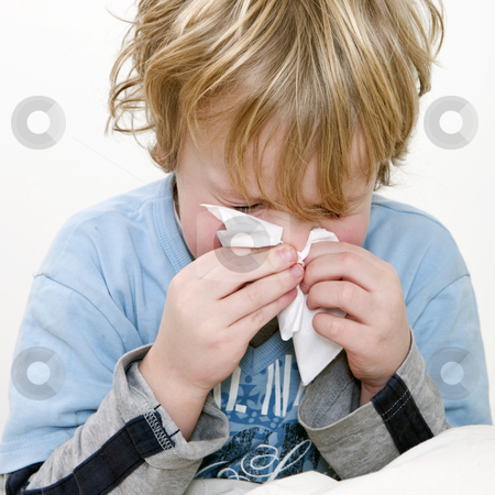 Sneeze stock photo, Young boy sneezing in a handkerchief, square close up by Corepics VOF