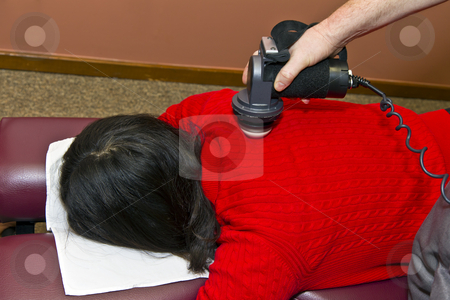 Back Work by Chiropractor stock photo, Chiropractor working on patient's upper back/lower neck - shot on location by tab62