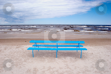 Blue bench on the beach  stock photo, Blue bench on the beach sand near the sea.  by sauletas