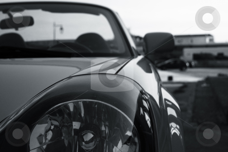 Sportscar closeup stock photo, Desaturated photo of a cabrio sportscar. by Konstantinos Kokkinis