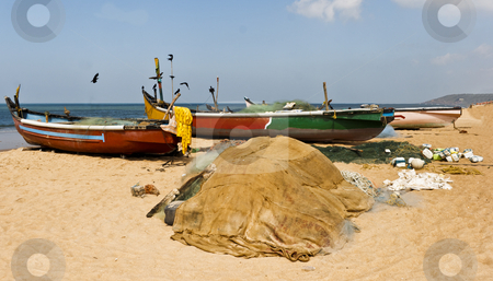 Fishing boats crows beach and sea stock photo, beach scene at calangute goa india by Kantilal Patel