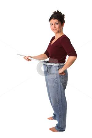 Successful weightloss stock photo, Pretty brunette showing how much weight she has lost by Simone Van den Berg