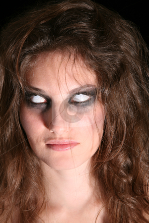 Scary eyes stock photo, Woman turning her eyes up and showing only white by Simone Van den Berg