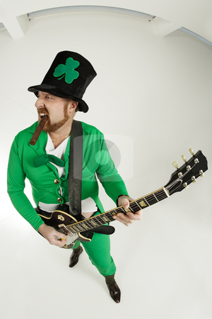 Rock and roll Leprechaun stock photo, An image of a Leprechaun playing electric guitar.  by © Ron Sumners
