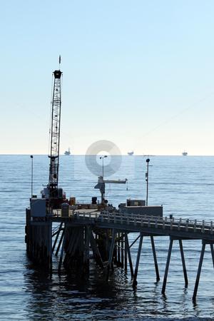 Carpinteria Pier stock photo, Carpinteria Pier with oil rigs at the horizon line by Henrik Lehnerer