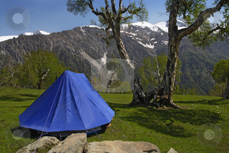 Tent in the mountains stock photo, A single blue tent in the Himalayas, with the mountains in the background. by © Ron Sumners