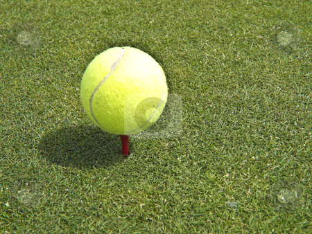 Tennis ball golf stock photo, tennis ball resting on a golf tee ready for the next stroke by Juliane Jacobs