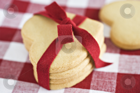 Heart shaped cookies with a red ribbon stock photo, Heart shaped cookies with a red ribbon by tish1