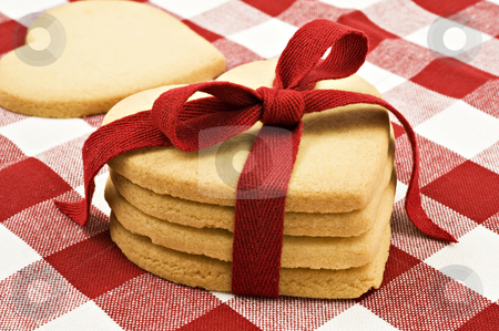 Heart shaped cookies with red ribbon stock photo, Heart shaped cookies with red ribbon on cloth by tish1