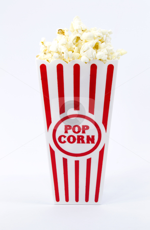 Popcorn in Red and White Container stock photo, Popped popcorn piled high in red and white striped container by Florence McGinn