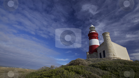 Lighthouse, Cape Agulhas stock photo, The Cape Agulhas lighthouse is situated at the southern most tip of Africa, built in the 1848. Cape Agulhas is the geographic southern tip of the African continent and dividing point between the Atlantic and Indian oceans (South Africa). by instinia