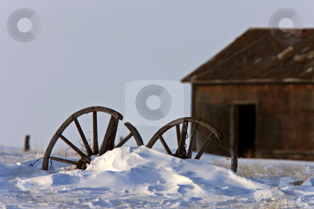 Wagon Wheel in Winter Saskatchewan stock photo, Wagon Wheel in Winter Saskatchewan by Mark Duffy