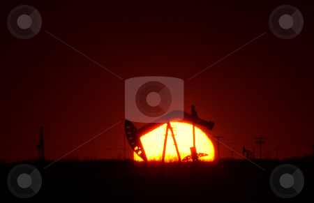 Oil pump in Saskatchewan field at sunset stock photo, Oil pump in Saskatchewan field at sunset by Mark Duffy