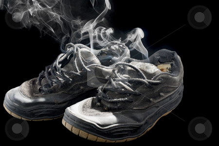 Rotten old sneakers stock photo, pair of smelly old sneakers on a black background by Stephen Gibson