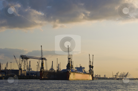 Docks stock photo, docks along the Elbe in Hamburg at sunset by Juliane Jacobs