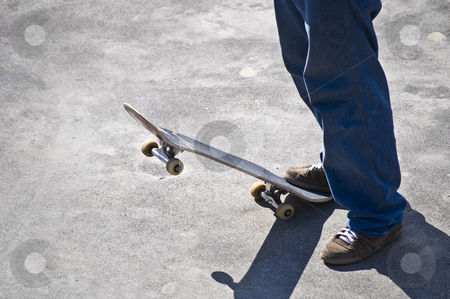 Skateboarder stock photo, young man spending his free time with his board by Juliane Jacobs