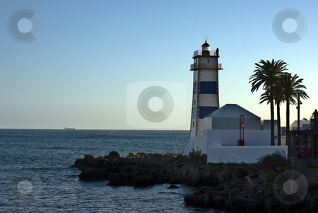 Lighthouse in Cascais stock photo, beautiful lighthouse in the harbor of Cascais by Juliane Jacobs
