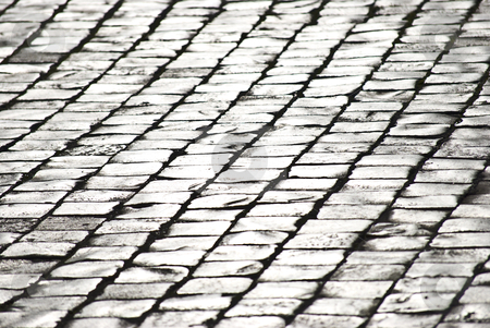 Cobblestones stock photo, pavement of grey old cobblestones shining in the sunlight by Juliane Jacobs