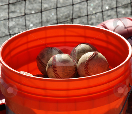 Bucket of ball stock photo, a closeup view of an orange ball bucket  by Tim Markley