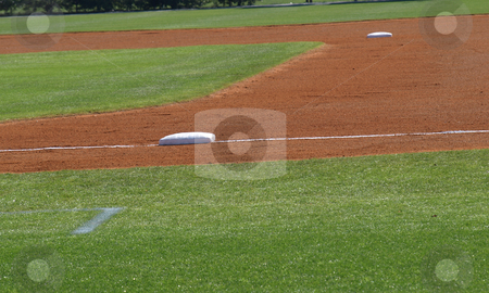 Infield stock photo, A view of the bases on a baseball field by Tim Markley