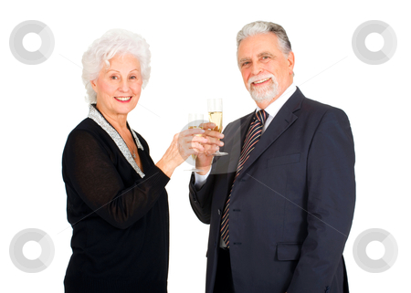 Elegant elderly couple toasting stock photo, elegant elderly couple toasting by ambrophoto