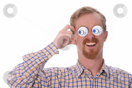 Very funny young man stock photo, Very funny young man with toys on his eyes by vladacanon1