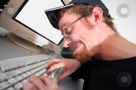 Mad programmer stock photo, mad programmer sitting at a computer desk by vladacanon1