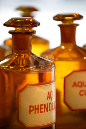 Vintage pharmacy bottles stock photo, An image of vintage chemical bottles in a pharmacy. by © Ron Sumners