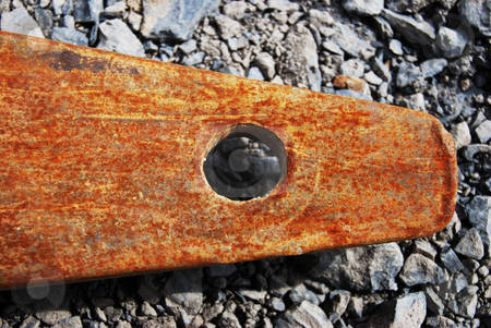 Rusty tool stock photo, closeup of a rusty metal piece on grey pebbles by Juliane Jacobs