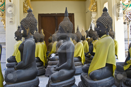 Buddha stock photo, lots of statues of buddha sitting in lines by Juliane Jacobs