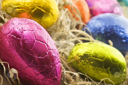 Colorful easter eggs in straw stock photo, Colorful easter eggs in straw - close up with shallow depth of field by tish1