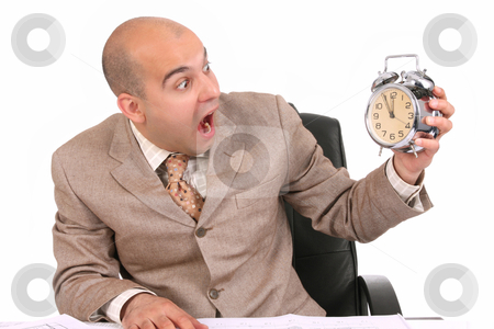 Businessman looking at clock alarm stock photo, businessman looking at clock alarm at a desk by vladacanon1