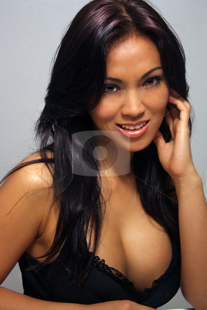 Beautiful Smiling Asian Girl (1) stock photo, A lovely young Indonesian model with long, luscious black hair, arresting brown eyes, and a bright, warm smile. by Carl Stewart