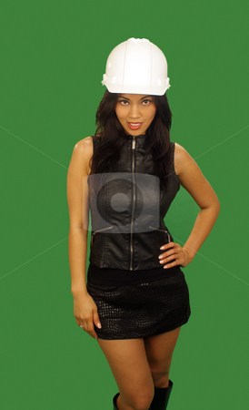 Beautiful Asian Female Construction Worker (4) stock photo, A lovely young and fashionable Indonesian model with long, luscious black hair, wearing a white hardhat, isolated on a plain green background. by Carl Stewart