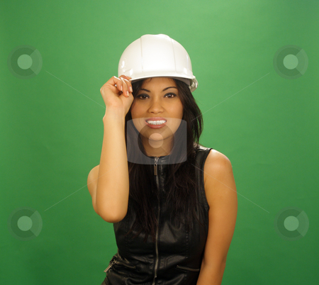 Beautiful Asian Female Construction Worker (5) stock photo, A lovely young and fashionable Indonesian model with long, luscious black hair and a bright, warm smile, wearing a white hardhat, isolated on a plain green background. by Carl Stewart