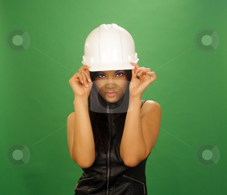 Beautiful Asian Female Construction Worker (6) stock photo, A lovely young and fashionable Indonesian model with long, luscious black hair and a bright, warm smile, wearing a white hardhat, isolated on a plain green background. by Carl Stewart