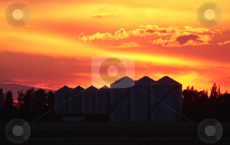 Colorful twilight and granary silhouettes stock photo, Colorful twilight and granary silhouettes by Mark Duffy