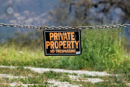 Private property stock photo, black orange white private property hanging sign by Henrik Lehnerer