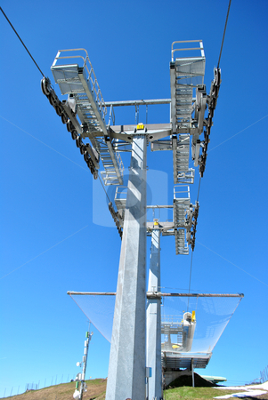 Ski lifts stock photo, ski lifts in the rocky mountains of the Dolomites by freeteo