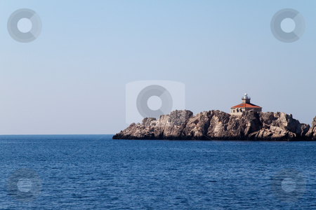 Costal Lighthouse stock photo, A lone lighthouse on a small island by Kevin Tietz