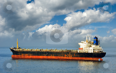 Empty cargo ship  stock photo, Old and rusty cargo ship laying empty, due to state of world economy by Andreas Karelias