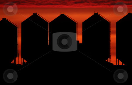 Set sun backlighting farm buildings stock photo, Set sun backlighting farm buildings by Mark Duffy