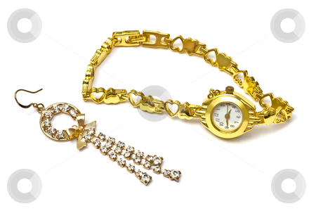 Golden watch and earring stock photo, Woman golden wrist watch and earring isolated on white background   by Ingvar Bjork