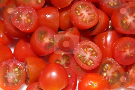 Chopped Cherry Tomatoes Up-Close stock photo, A pile of chopped of red cherry tomatoes.  by Chris Hill